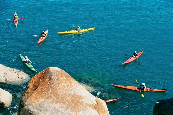 Canoes on Granite Island: a great place to visit in Victor Harbor.  Image © Fleurieu Peninsula Tourism; Johnny . This photo sponsored by Cabinets Category.
