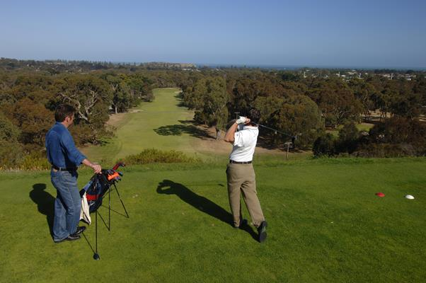 Playing Golf at Victor Harbour Golf Course: a great place to visit in Victor Harbor.  Image © SATC; Adam Bruzzone. This photo sponsored by Charitable Institutions Category.