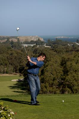 Playing Golf at Victor Harbour Golf Course: a great place to visit in Victor Harbor.  Image © SATC; Adam Bruzzone. This photo sponsored by Removalists Category.