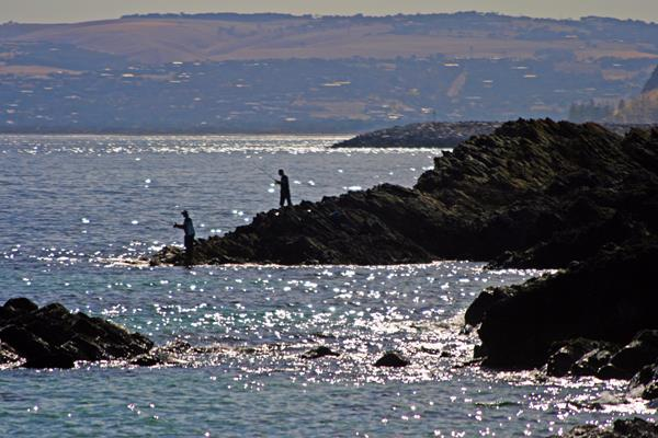 Fishing off the Rocks: a great place to visit in Victor Harbor.  Image © Fleurieu Peninsula Tourism; SATC. This photo sponsored by Property Management Category.